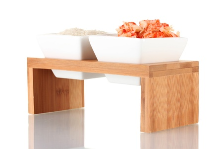 appetize: rice and shrimp in bowls on wooden stand isolated on white