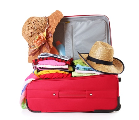 open suitcase: Open red suitcase with clothing isolated on a white Stock Photo