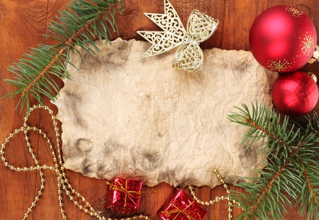 Christmas card on wooden table photo