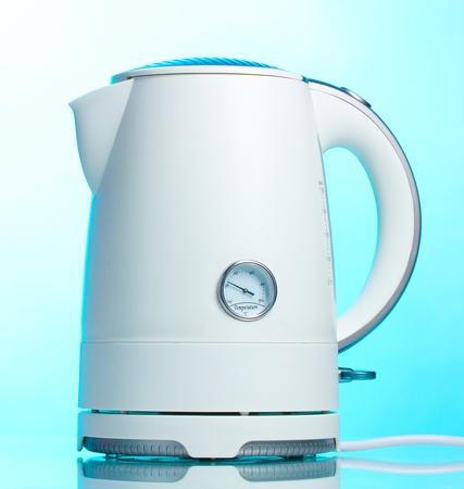 electric tea kettle: White electric kettle on blue Stock Photo