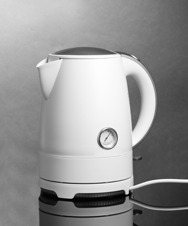 electric tea kettle: White electric kettle on grey