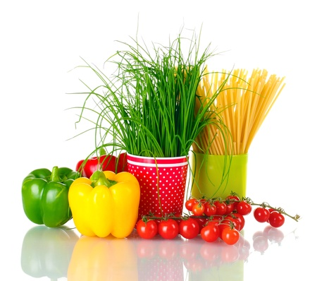 green onion and spaghetti in cups, paprika and tomatoes cherry isolated on white photo