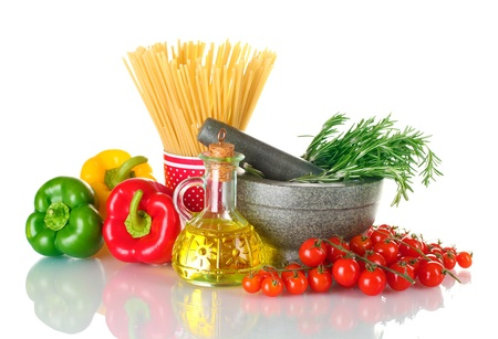 spaghetti in cup, rosemary in mortar, oil in jar paprika, tomatoes cherry, and onion isolated on white photo