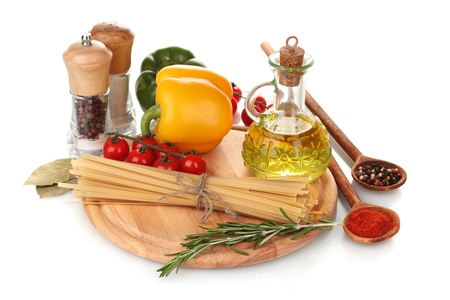 spaghetti, jar of oil, spices and vegetables on wooden board isolated on white Stock Photo - 11665179