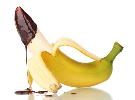 Open banana with chocolate isolated on white photo
