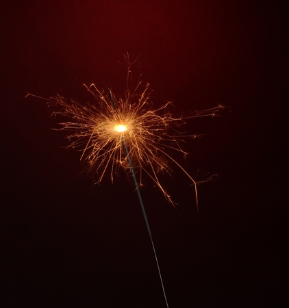 beautiful sparkler on red background Stock Photo - 11665013