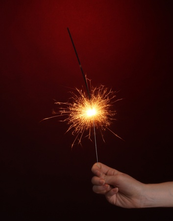 beautiful sparkler on red background Stock Photo - 11665129