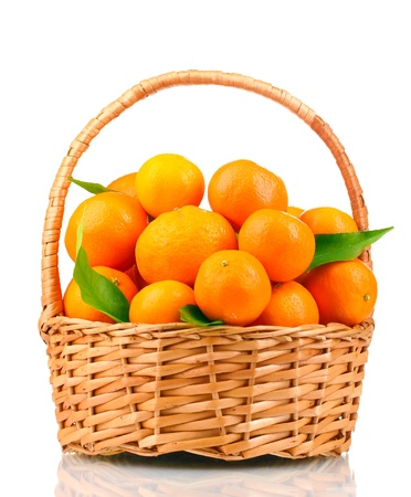 tangerines with leaves in a beautiful basket isolated on white photo