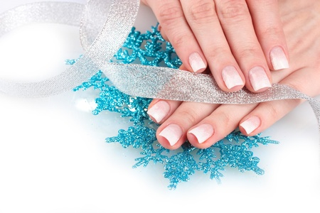 hands with beautiful winter design, snowflakes and ribbon solated on white photo