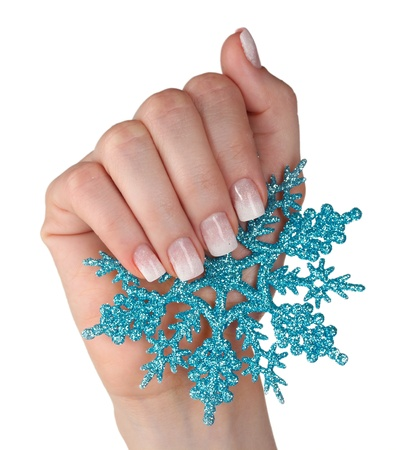 hand with beautiful winter design and snowflake isolated on white photo
