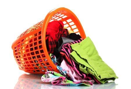 dropped: Clothes in orange plastic basket dropped isolated on white