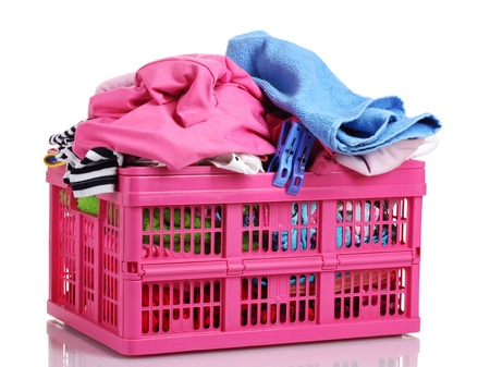 Clothes in pink plastic basket isolated on white Stock Photo - 11725876