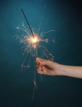 beautiful sparkler on blue background photo