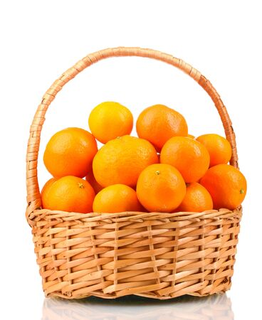 tangerines in a beautiful basket isolated on white photo