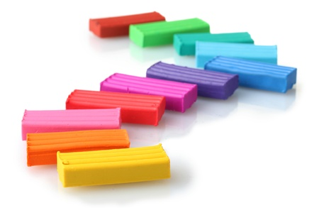 Children bright plasticine isolated on white Stock Photo - 11724944