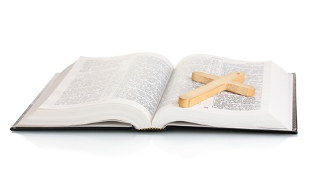Russian bible and wooden cross isolated on white photo