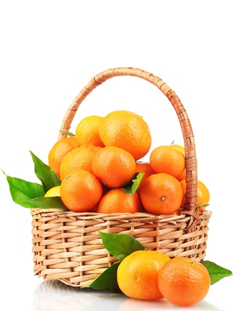 tangerines with leaves in a beautiful basket isolated on white Stock Photo - 11831815