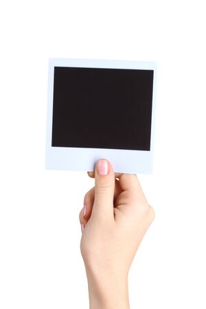 One photo paper in hand isolated on white photo