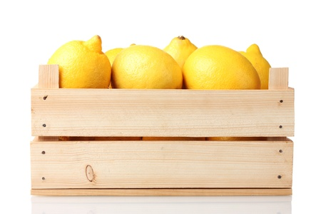 ripe lemon in wooden box isolated on white Stock Photo - 11832040