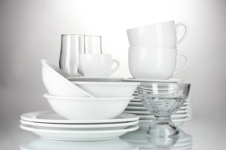 porcelain: empty bowls, plates, cups and glasses isolated on white