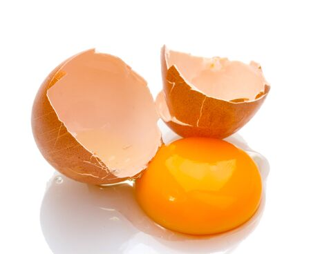 Brown egg with yolk isolated on white