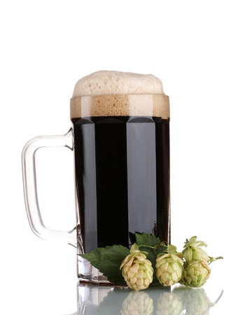 dark beer in a mug and green hop isolated on white Stock Photo - 11831522