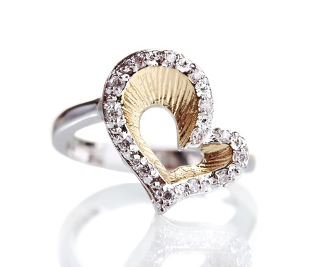 diamond jewellery: beautiful ring with precious stones isolated on white