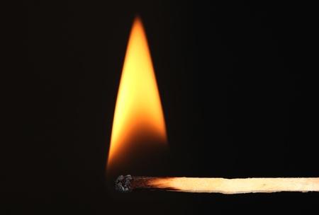 Burning match on black background Stock Photo - 11831581