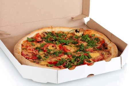 delicious pizza with sausage and vegetables in the package isolated on white photo