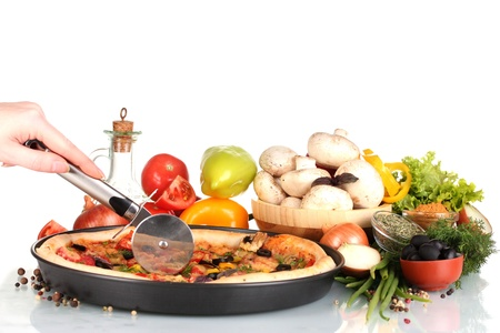 delicious pizza on plate, vegetables and spices isolated on white photo