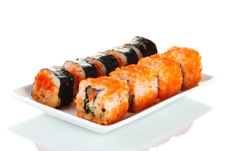 delicious sushi on plate isolated on white photo
