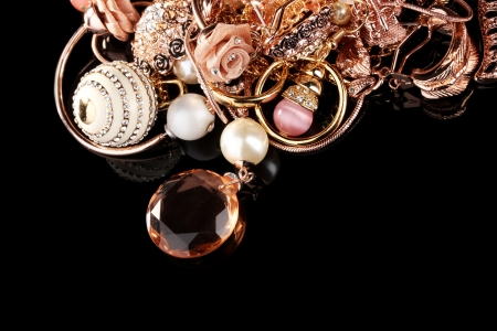 Various gold jewellery on black Stock Photo - 11911975