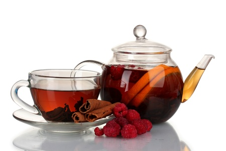 Glass teapot and cup with black tea of raspberries,orange, lime isolated on white photo
