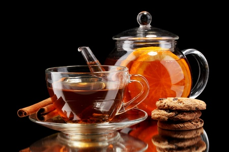 Glass teapot and cup with black fruit tea and cookies isolated on white Stock Photo - 11911777