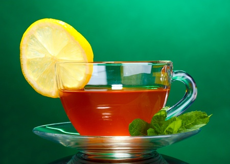 tea with lemon and mint on black background photo