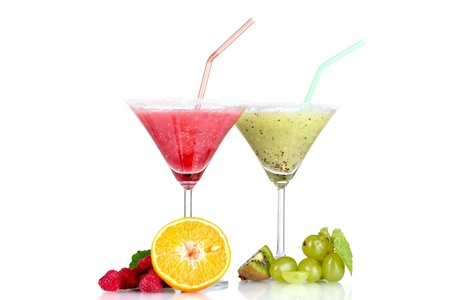 Delicious fruit smoothies and fruit isolated on white photo