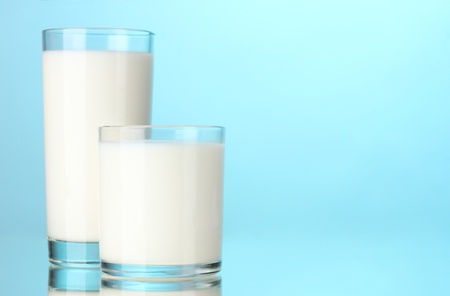 Two glass of milk on blue Stock Photo - 12020573