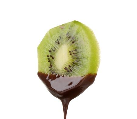 blanketed: slice of ripe kiwi with chocolate isolated on white Stock Photo
