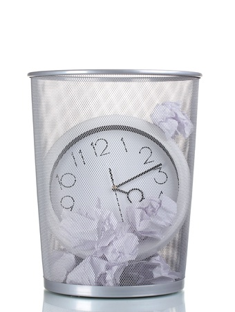 spent: Wall Clock in metal trash bin and paper isolated on white