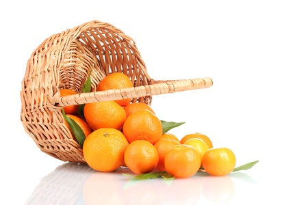 tangerines with leaves in a beautiful basket isolated on white Stock Photo - 12020629
