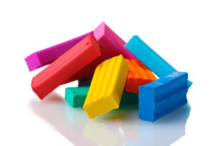 Children bright plasticine isolated on white Stock Photo - 12021251