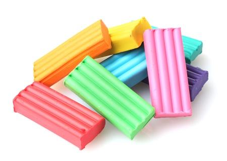 Children bright plasticine isolated on white Stock Photo - 12021319