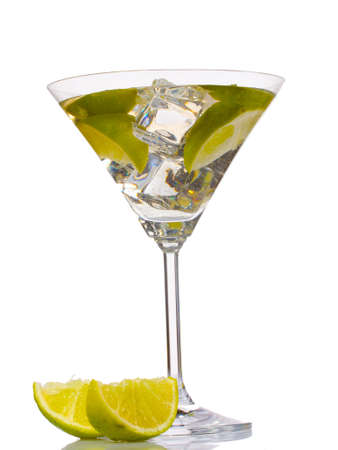 cocktail with ice, lemon and green lime isolated on white photo