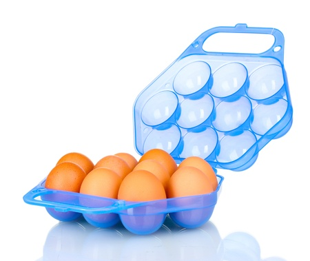 Eggs in blue plastic box isolated on white photo
