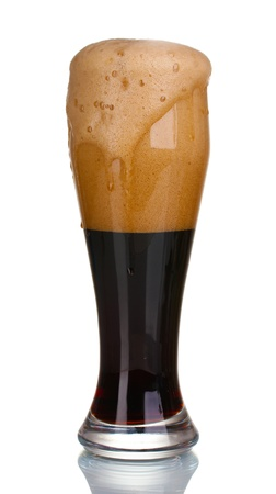 dark beer poured into a glass isolated on white photo