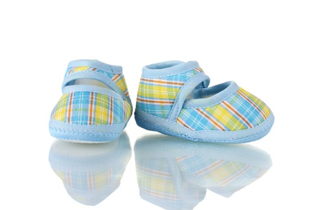 Blue baby shoes isolated on white photo