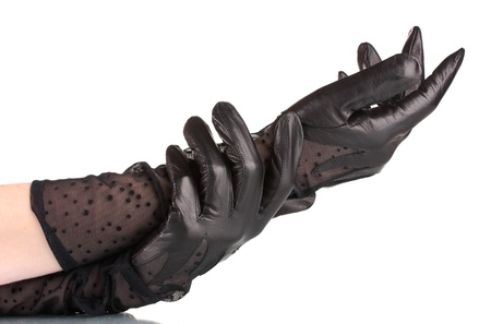 handen van vrouwen in zwarte lederen handschoenen geïsoleerd op wit Stockfoto