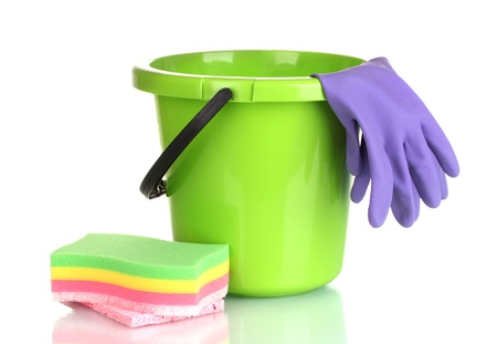 bright housekeeping: bucket, gloves and sponge for cleaning isolated on white