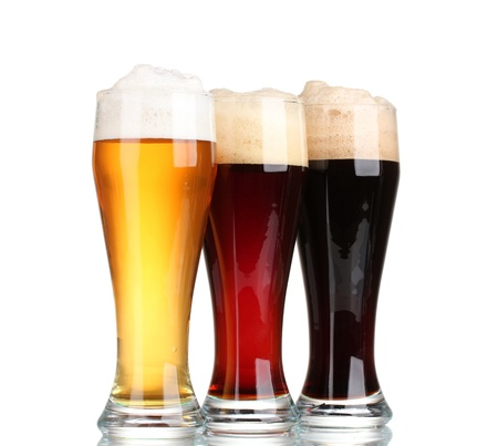 mug of ale: three glasses with different beers isolated on white Stock Photo