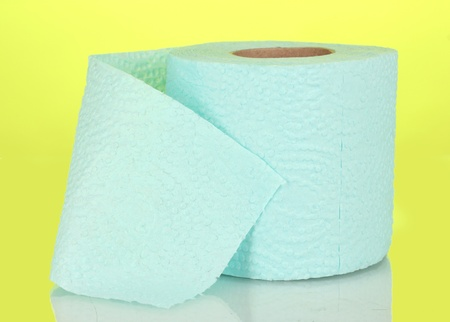 blue roll of toilet paper on yellow background Stock Photo
